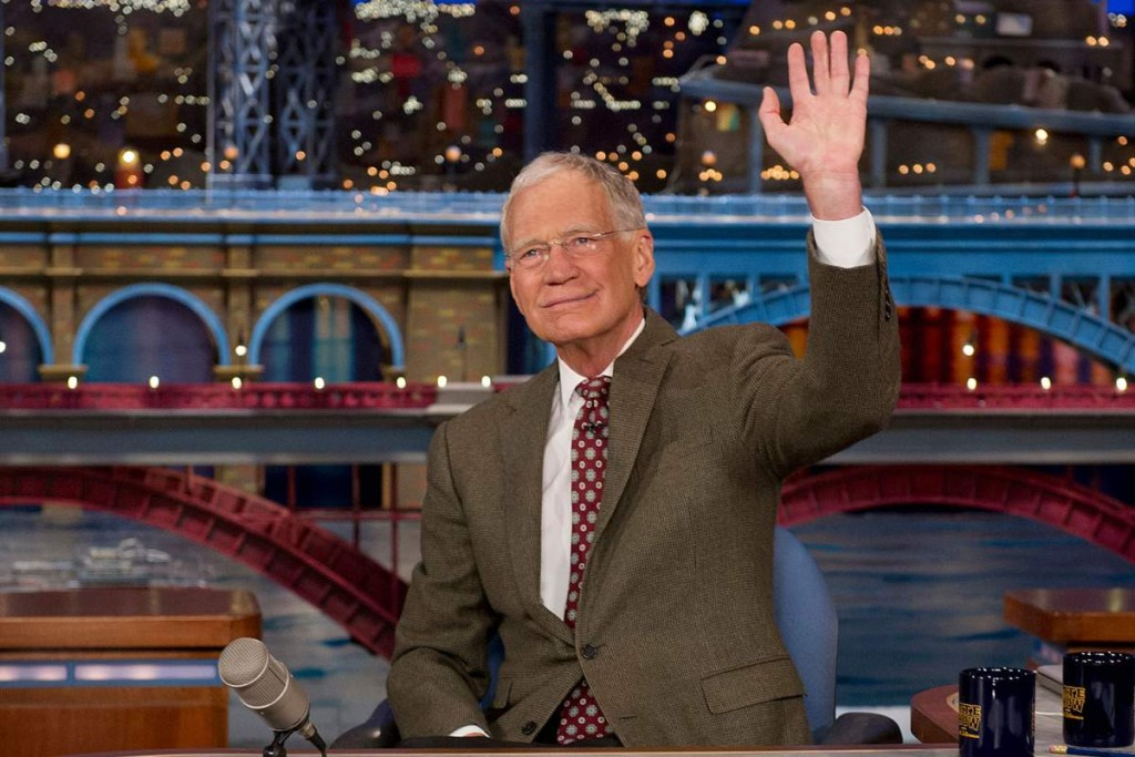 "In this photo provided by CBS, David Letterman, host of the ""Late Show with David Letterman,"" waves to the audience in New York on Thursday, April 3, 2014, after announcing that he will retire sometime in 2015. Letterman, who turns 67 next week, has the longest tenure of any late-night talk show host in U.S. television history, already marking 32 years since he created ""Late Night"" at NBC in 1982. (AP Photo/CBS, Jeffrey R. Staab) MANDATORY CREDIT, NO SALES, NO ARCHIVE, FOR NORTH AMERICAN USE ONLY"
